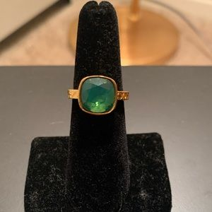 Vibrant gold and green Coach ring